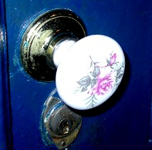 Hand painted porcelain door handle.