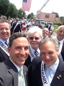 "Senator Jack Martins takes a ""selfie"" with County Executive Ed Mangano and members of the Village Board"