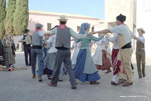 Dancing in clircles.  Folk dancing group in Loulé, Portugal.