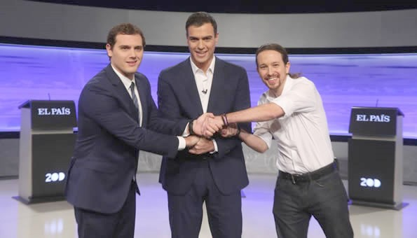 Albert Rivera, Pedro Sánchez and Pablo Iglesias greet each other before the debate promoted by the daily El Pais.