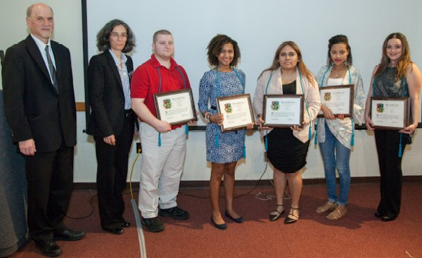 From left, Ron Pitt, vice president for academic affairs; Sílvia Oliveira, associate professor of modern languages; and students Ryan Viveiros, Wilma Varela, Karen Ramirez, Marcia Ramos and Lelia Noble,