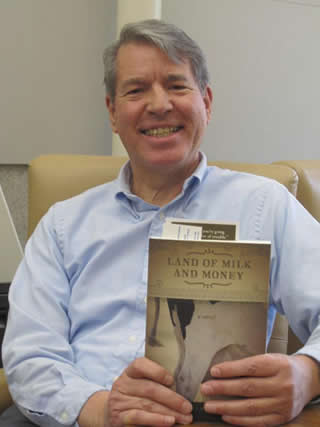 Author Anthony Barcellos with his novel.