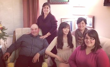 Margie Vieira (standing) with her husband and three daughters.