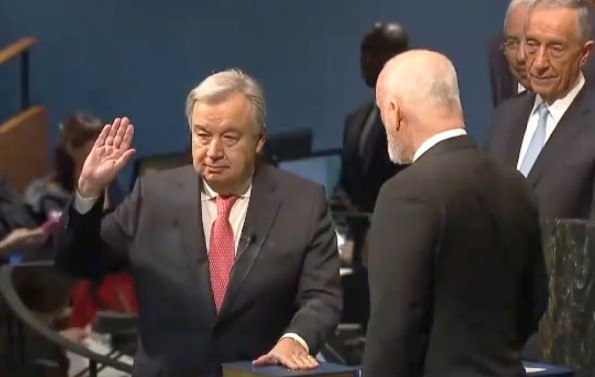 Antonio Guterres (right hand up) is sworn in by Peter Thompson, president of the 71st. session of the UN General Assembly. At right, in the background is the President of Portugal, Marcelo Rebelo de Sousa.